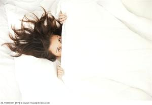 Woman, under covers