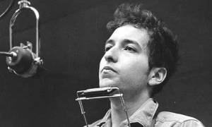 Young bob dylan with harmonica