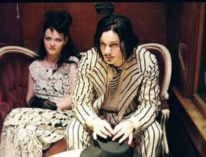 jack and meg white in white suits with black pinstripes
